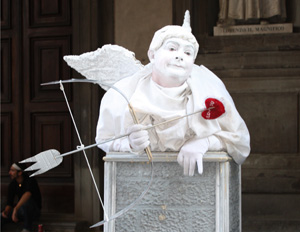 A live Italian Cupid statue